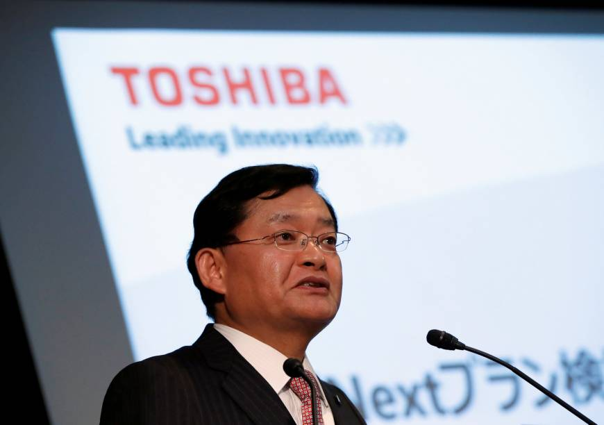 Toshiba books first net profit in four years
