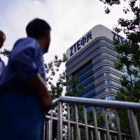 Trump says China's ZTE to pay $1.3 billion fine to stay in business