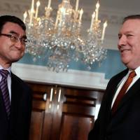 U.S. Secretary of State Mike Pompeo (right) and Japanese Foreign Minister Taro Kono face reporters before their meeting at the State Department in Washington Wednesday. | REUTERS