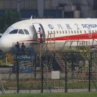China, Airbus probe blown-out windshield on jetliner that almost sucked co-pilot out