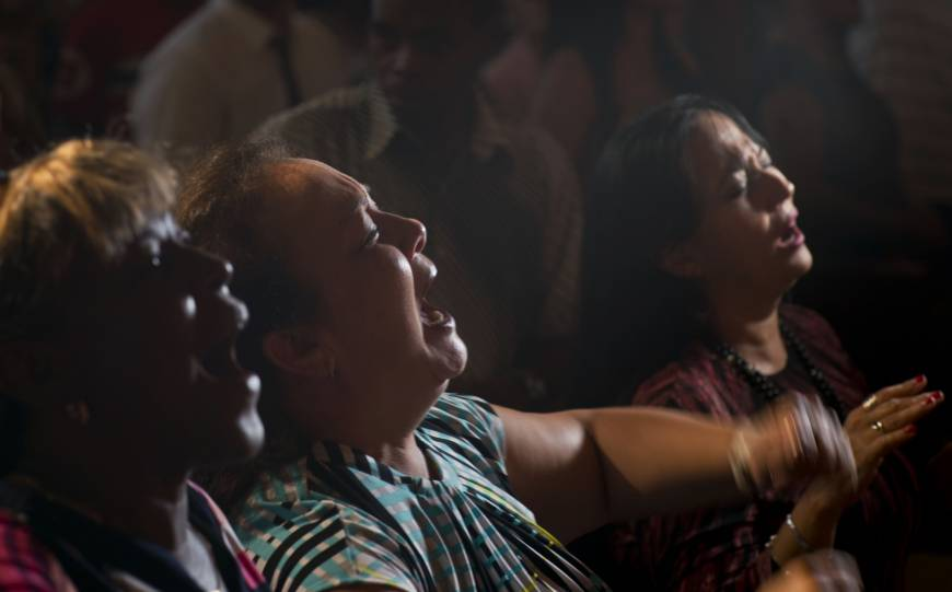 Evangelicals pray and cry during a service in memory of those who died in a plane crash in Havana Sunday. Officials say 110 people died when a charter passenger jet hired by Cuba's state-run airline, Cubana de Aviacion, crashed Friday in the rural outskirts of Havana. | AP
