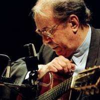 Joao Gilberto is shown during a performance in 2006. | TUCA VIEIRA / CC BY-SA 2.0