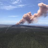 In this photo provided by the U.S. Geological Survey, red ash rises from the Puu Oo vent on Hawaii's Kilauea Volcano after a magnitude 5.0 earthquake struck the Big Island Thursday in Hawaii Volcanoes National Park. The temblor Thursday is the latest and largest in a series of hundreds of small earthquakes to shake the island's active volcano since the Puu Oo vent crater floor collapsed and caused magma to rush into new underground chambers on Monday. Scientists say a new eruption in the region is possible. | KEVAN KAMIBAYASHI / U.S. GEOLOGICAL SURVEY / VIA AP