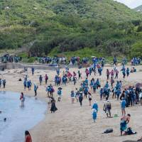 Over 2,000 volunteers take part in Hong Kong beach cleanup to help turtles