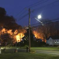 Official: Connecticut woman held hostage for days, fled before deadly blast
