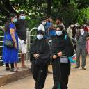 People wearing masks are seen at a hospital in Kozhikode in the southern state of Kerala, India, on Monday.