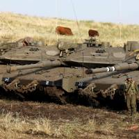 Restraint urged after Israel retaliates against alleged Iranian fire from positions in Syria