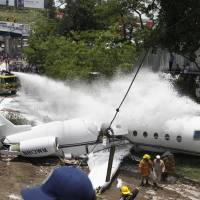 All aboard survive as biz jet crashes, breaks in two on Tegucigalpa runway