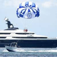 The Cayman Island-registered vessel Equanimity, which is reportedly worth some $250 million and is owned by Jho Low, a former unofficial adviser to the Malaysian fund 1MDB, sits in waters off Tanjung Benoa on the Indonesia's resort island of Bali on April 4. | AFP-JIJI