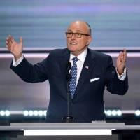 Former New York City Mayor Rudy Giuliani addresses delegates on the first day of the Republican National Convention in Cleveland in 2016. Giuliani, lawyer to President Donald Trump, says the investigation into Russian interference in the 2016 election and possible collusion with Trump's campaign will end by Sept. 1. | AFP-JIJI