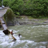 At least five dead, 11 missing as bridge collapses into raging river in Kashmir