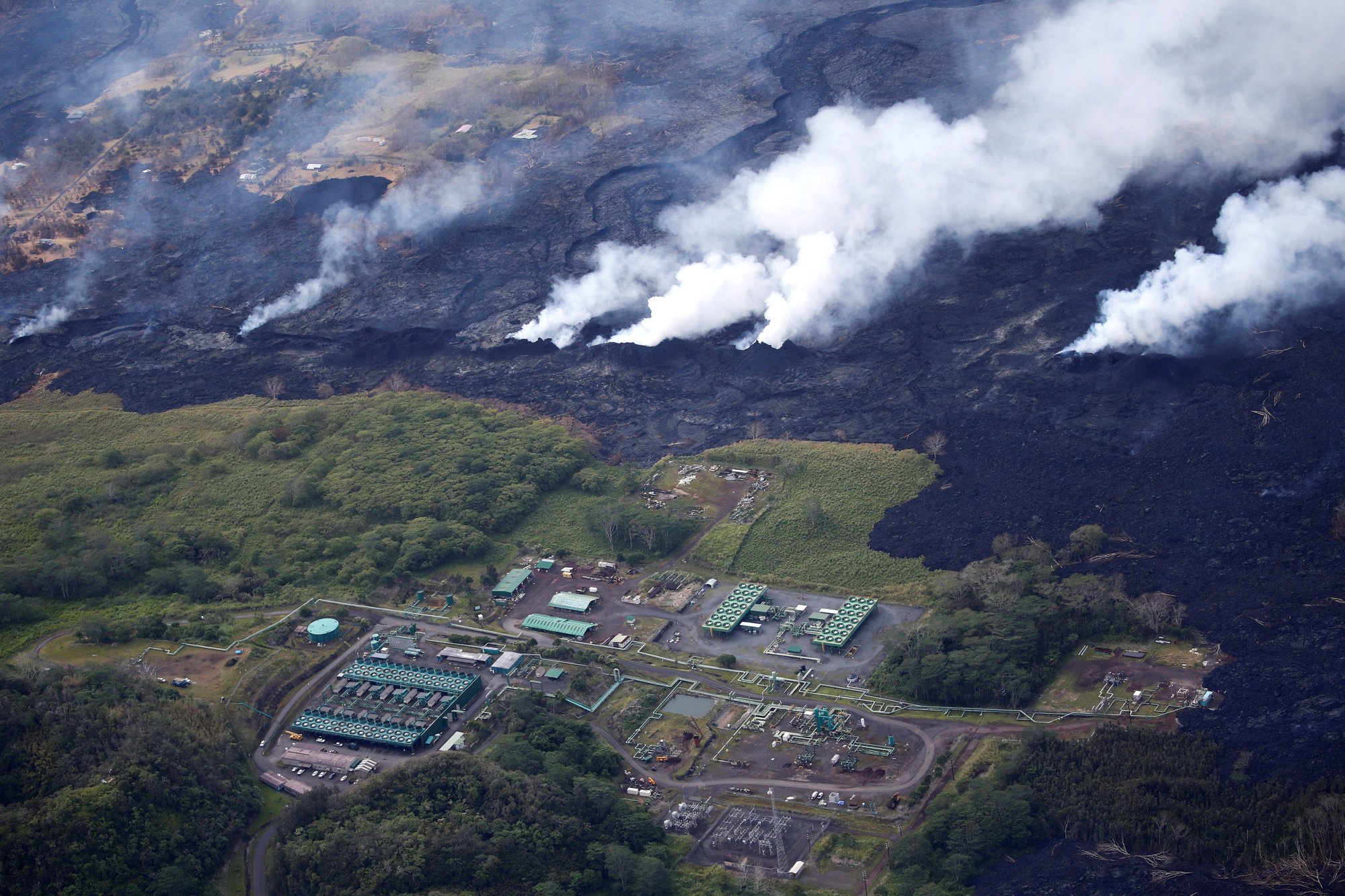 Lava approaches the Puna Geothermal Venture in the Leilani Estates near Pahoa, Hawaii, Monday. | REUTERS