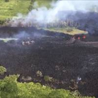 In this Sunday frame from video released by the U.S. Geological Survey, gases rise from a fissure near Pahoa, Hawaii.   U.S. GEOLOGICAL SURVEY / VIA AP