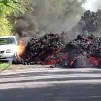 Lava engulfs a Ford Mustang in Puna, Hawaii, Sunday in this still image obtained from social media video. | WXCHASING / VIA REUTERS