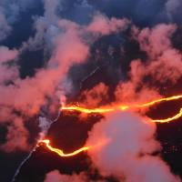 This image released by the U.S. Geological Survey on Friday shows what the Hilo Civil Air Patrol captured on May 23 in this evening photograph of the coastline where lava flows are entering the sea,as there are currently three primary ocean entry points, which have evolved over the course of the eruption. | US GEOLOGICAL SURVEY /  J. OZBOLT, HILO CIVIL AIR PATROL / HO VIA AFP-JIJI