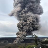 Ash rises from Mount Kilauea on Wednesday. | REUTERS