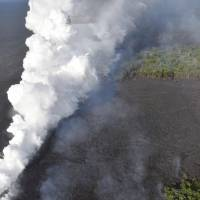 Kilauea-hurled lava crushes man's leg, flows fast into sea, forms huge toxic cloud