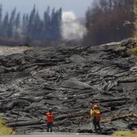 'Lava tide' from Kilauea swallows street as many more homes burn in Hawaii
