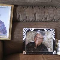 Photos of Lessie Brown rest on a chair in Cleveland Heights, Ohio, Friday. | DAVID PETKIEWICZ / THE PLAIN DEALER / VIA AP