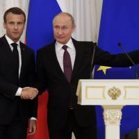 During meeting with Macron, Putin calls Trump scrubbing of North Korea summit regrettable