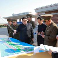 North Korean leader Kim Jong Un inspects the construction of the Wonsan-Kalma Shore Tourist Zone in this photo released Friday. | REUTERS