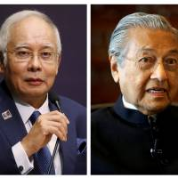 Malaysia's Prime Minister Najib Razak (left) and former Prime Minister Mahathir Mohamad are facing off in an election.   REUTERS