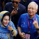 Then-Malaysian Prime Minister Najib Razak and his wife, Rosmah Mansor, show their ink-stained fingers after voting in Malaysia's general election in Pekan, Pahang on May 9.