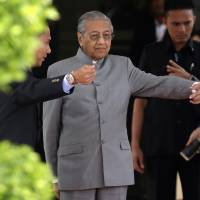 Malaysia's Prime Minister Mahathir gets down to work after historic poll win