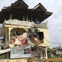 A year after Islamic State-affiliate fighters began Marawi siege in the Philippines, scars and bombs linger