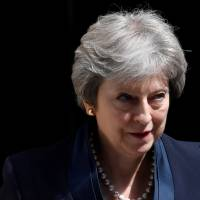May refuses to relax Northern Ireland abortion curbs despite its southern neighbor's historic vote to liberalize