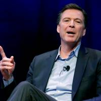 Former FBI director James Comey speaks about his book during an onstage interview with Axios Executive Editor Mike Allen at George Washington University in Washington April 30. | REUTERS