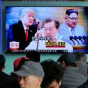 People watch a TV screen showing images of North Korean leader Kim Jong Un (right), South Korean President Moon Jae-in (center) and U.S. President Donald Trump at the main railway station in Seoul on March 7.
