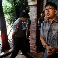 Witness says Myanmar police searched Reuters pair's phones without warrant
