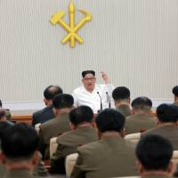 North Korean leader Kim Jong Un speaks during the first enlarged meeting of the seventh Central Military Commission of the Workers' Party of Korea in this undated photo released Friday. | REUTERS