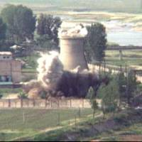 The demolition of the cooling tower at North Korea's Nyongbyon reactor complex is seen in June 2008. The North's Foreign Ministry said Saturday it will hold a 'ceremony' for the dismantling of its nuclear test site on May 23-25 in what would be a dramatic but symbolic event to set up the summit meeting between Kim Jong Un and U.S. President Donald Trump scheduled for next month. | AP