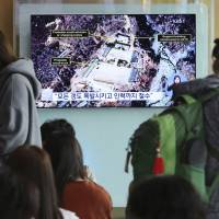 A TV screen shows a satellite image of the Punggye-ri nuclear test site in North Korea during a news program at the main railway station in Seoul on Sunday. North Korea said Saturday that it will dismantle the nuclear test site in less than two weeks.   AP