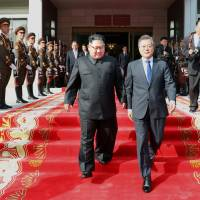 South Korean President Moon Jae-in and North Korean leader Kim Jong Un leave after their summit at the truce village of Panmunjom on the border separating the two Koreas on Saturday. | REUTERS