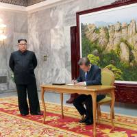 North Korean leader Kim Jong Un meets with South Korean President Moon Jae-in during their summit at the truce village of Panmunjom on the border separating the two Koreas on Saturday. | REUTERS