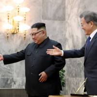 North Korean leader Kim Jong Un and South Korean President Moon Jae-in meet at the truce village of Panmunjom on Saturday. | REUTERS