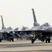Two U.S. Air Force F-16 fighters taxi down the flight line during the Max Thunder joint exercise with South Korea at Kunsan Air Base in the South in April last year. | U.S. AIR FORCE