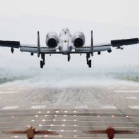 A U.S. Air Force A-10 Thunderbolt touches down at Osan Air Base in Pyeongtaek, South Korea, on Friday during the kickoff of joint military drills between the U.S. and South Korea. | AFP-JIJI