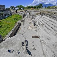 Archaeologists uncover street of balconies in Italy's Pompeii