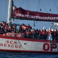 Rescuers blame U.K. and Italian 'red tape' while waiting with migrants at sea as conditions worsen