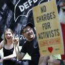 Chelsea Manning, left, cheers with Dylan Petrohilos, right, of Washington, as they attend a rally in support of the J20 defendants in Washington on May 11. Petrohilos was one of the people detained in Inauguration Day protests and the defendants face multiple felonies.