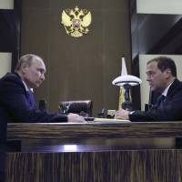 Russian President Vladimir Putin meets with Prime Minister Dmitry Medvedev in Sochi on Tuesday. | REUTERS