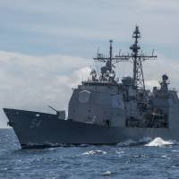 The guided-missile cruiser USS Antietam sails in the South China Sea in March 2016.   NAVY MEDIA CONTENT SERVICES