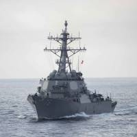 The guided-missile destroyer USS Higgins transits the Pacific Ocean last August.   NAVY MEDIA CONTENT SERVICES