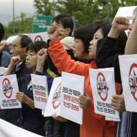 South Koreans rally against the Max Thunder joint military exercise between the United States and South Korea near the U.S. Embassy in Seoul on Wednesday. | AP