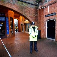 A police officer stands on duty outside a pub that has been secured as part of the investigation into the poisoning of former Russian intelligence agent Sergei Skripal and his daughter, Yulia, in Salisbury, Britain, March 12. | REUTERS
