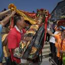 Villagers carry a statue of a Chinese god during a parade on the outlying Cheung Chau island in Hong Kong to celebrate the Festival of Buns on Tuesday.